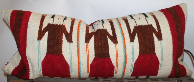 Navajo Indian weaving bolster pillow. With red ultra suede backing. Down & feather fill.
