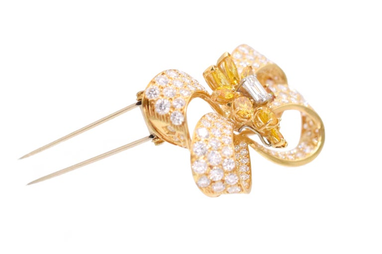 Round Cut Yellow and Colorless Diamond Bow Brooch For Sale