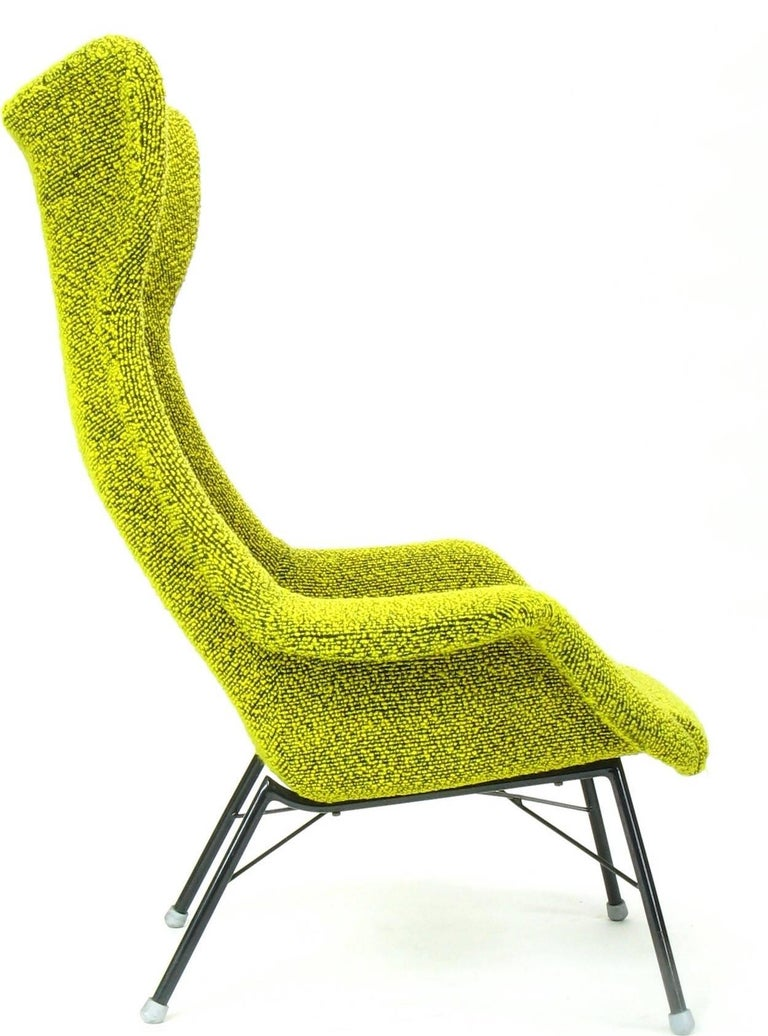 Wingback armchair designed by Miroslav Navratil. Produced by TON in Bystrice in the 1960s. The original yellow/green material (sheep's wool boucle) was cleaned and is in excellent condition. We also have in our offer the same model of the armchair