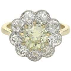 Yellow and White Diamond Cluster Ring Centred with a 1.39ct Fancy Yellow Diamond