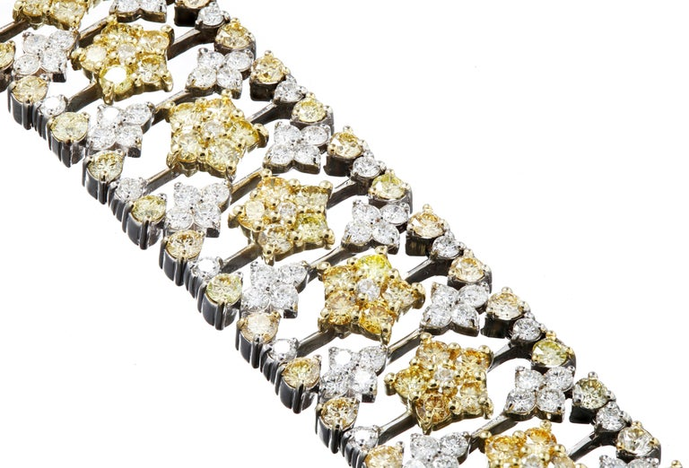 18K Two-Tone Gold Bracelet with White and Yellow Diamonds by Stambolian   Bracelet has 7.80 carat G color, VS clarity white diamonds 12.69 carat Yellow Diamonds  Limited piece. This is one of only Three made.  Clasp is where it reads