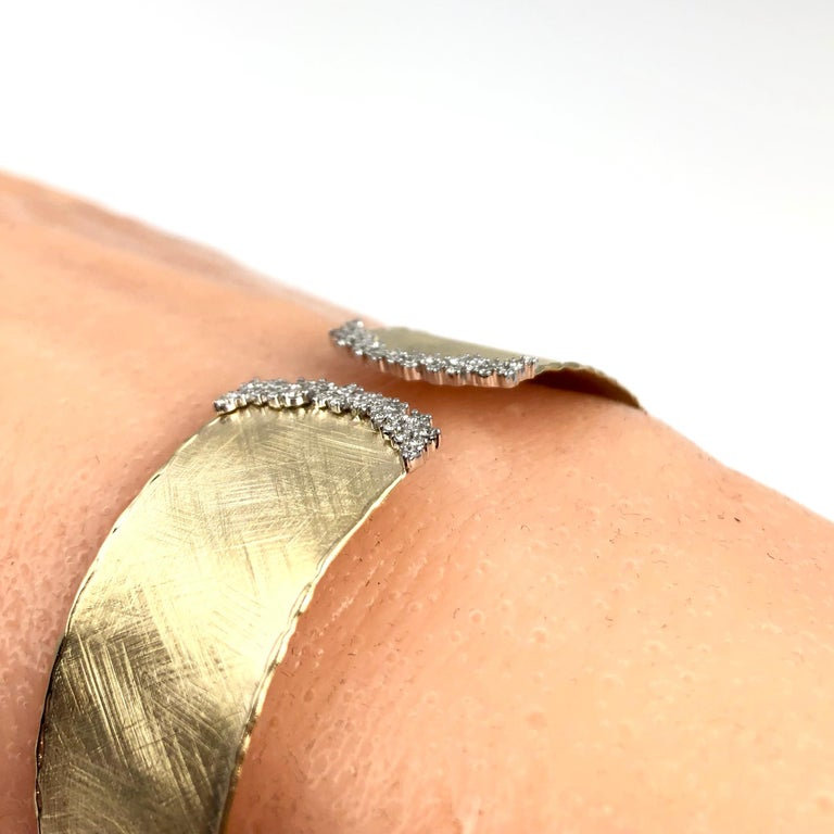 Contemporary Yellow and White Gold Rustic Bangle with .58 Carat Diamond Accent by DiamondTown For Sale