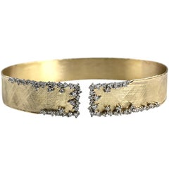 Yellow and White Gold Bangle with 0.78 Carat Diamond Accent