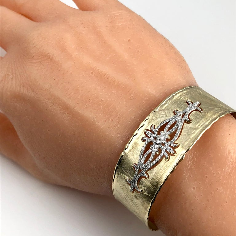 Contemporary Yellow and White Gold Rustic Bangle with .83 Carat Diamond Accent by DiamondTown For Sale