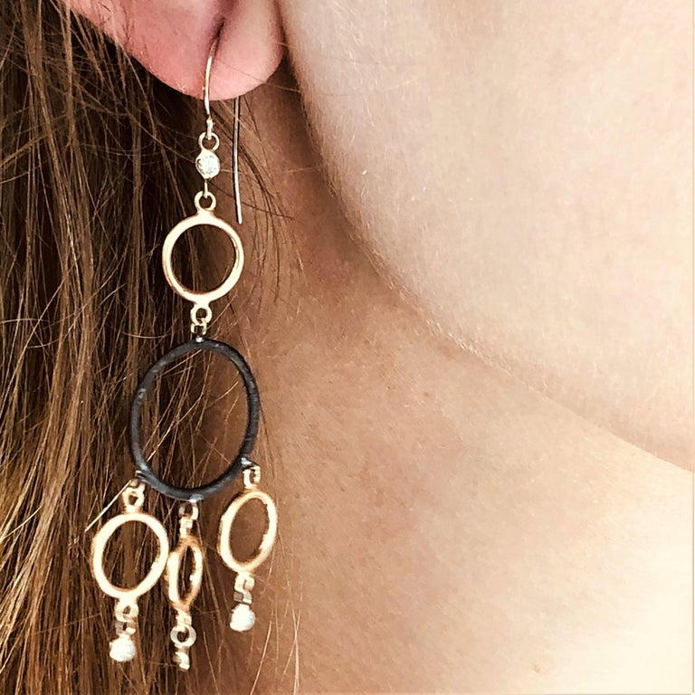 Fourteen karat yellow and white gold circles with bezel-set diamonds three inch long earrings Two Blacken silver circles   Diamond weight 0.25 carats 14 karat gold large hoops. New Earrings The latest and innovative fashion collections have been