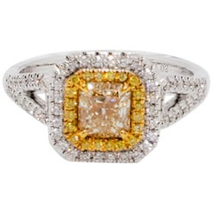 Yellow Diamond Radiant and White Diamond Cocktail Ring in 18 Karat Yellow Gold