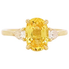 Yellow Engagement Ring Sapphire 2.33 Carat 18 Karat Three-Stone Diamonds