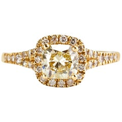 Yellow Gold 0.90 Carat Fancy Yellow Cushion Diamond Engagement Ring with a Halo
