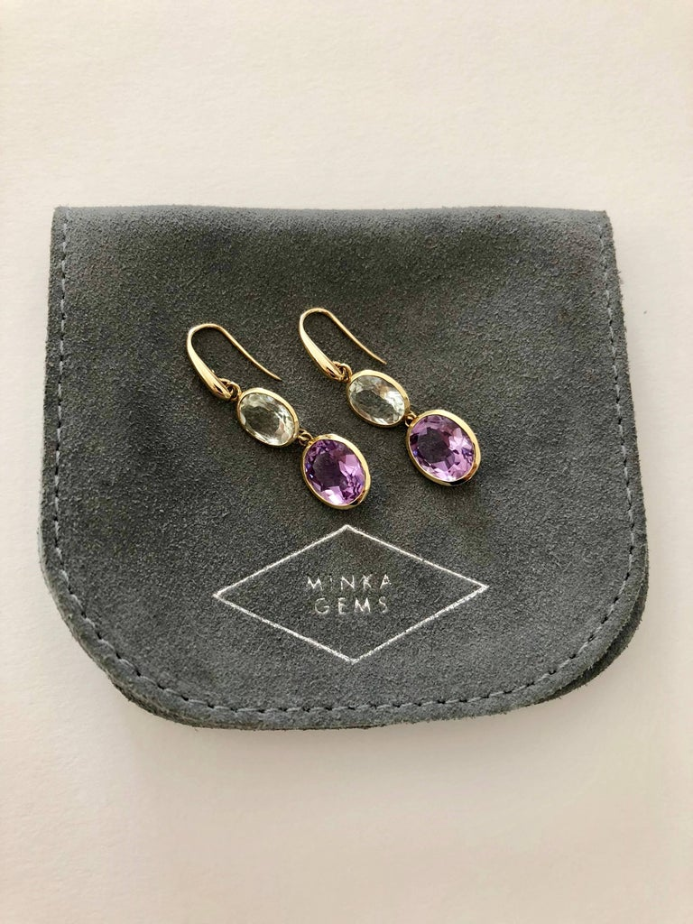 Indian Ocean Earrings - Stylish and elegant this stunning pair of earrings is made from 18kt yellow gold and semi precious stones. Designed and carefully hand crafted in the UK.  18 karat yellow gold 6.4 grams  Lilac Amethyst & Prasiolite gem