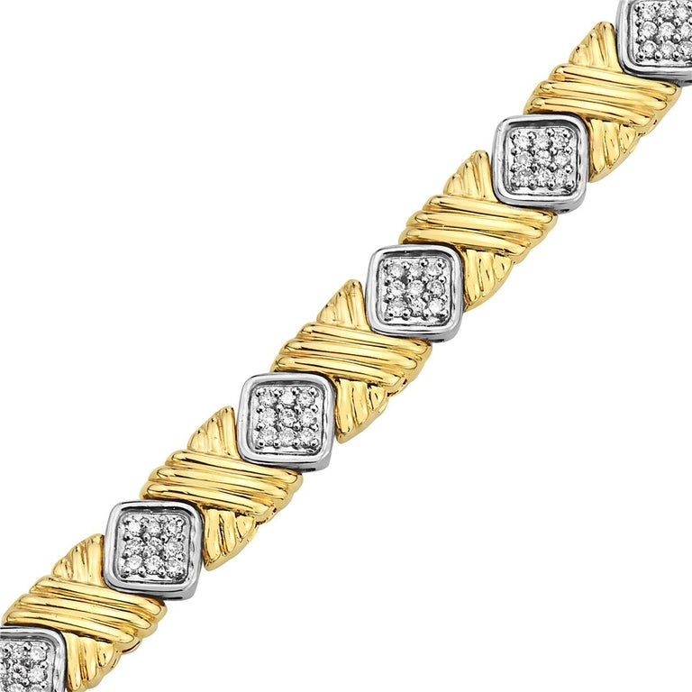 This bracelet features 1.08 carats of diamonds set in 14K yellow gold. 7 inch length. 27 grams total weight.  Resizeable upon request.  Viewings available in our NYC showroom by appointment.