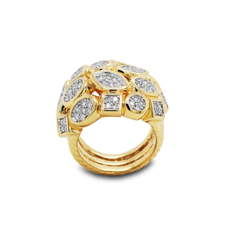 18K Yellow Gold and Diamond Cluster Ring  Beautiful hand made ring with unique design  1.40 carat diamonds total weight  Ring face is 0.80 inch width 0.45 inch band width  Ring is a size 7.5. Sizable.