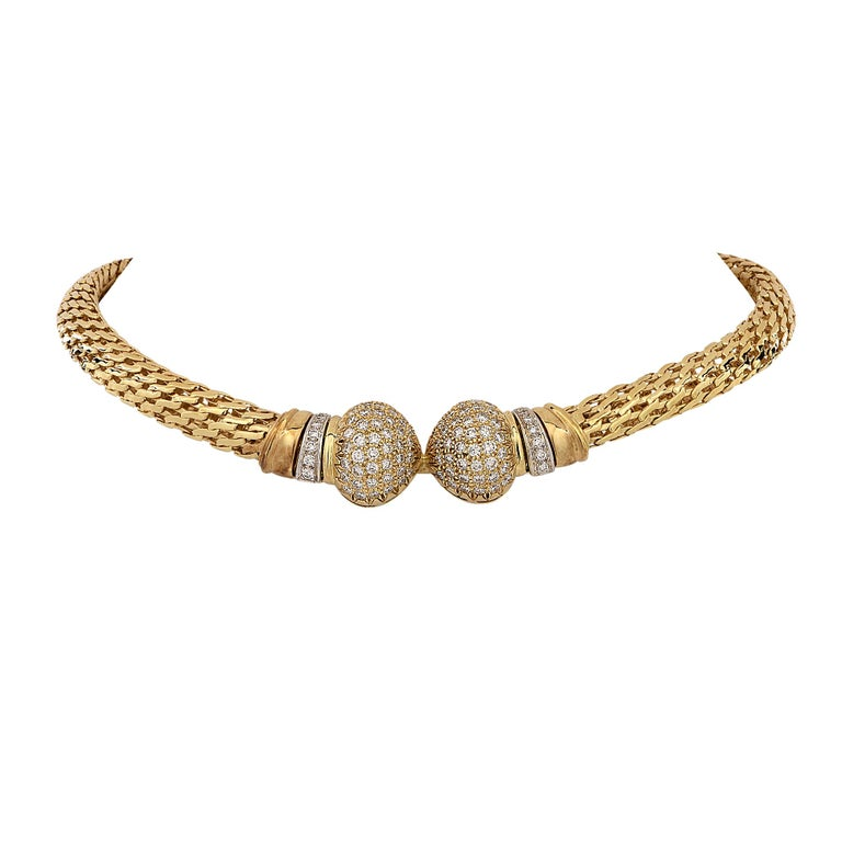 Striking necklace crafted in 18 karat yellow gold featuring 118 round brilliant cut diamonds weighing approximately 5.80cts G-H color and VS clarity. A woven 9.5 mm wide yellow gold chain snakes silkily around your neck and rests just below the