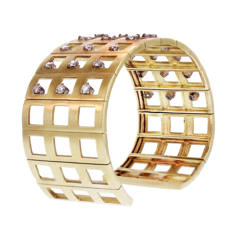 18K Yellow Gold and Diamond Cuff Bracelet  Beautifully made bracelet features 2.80 carat H color, SI clarity white diamonds. 27 total.  Bracelet is a size 7 and 1.15 inch in width  Made in USA