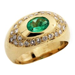 Yellow Gold and Diamond Ring with Oval Tsavorite Center