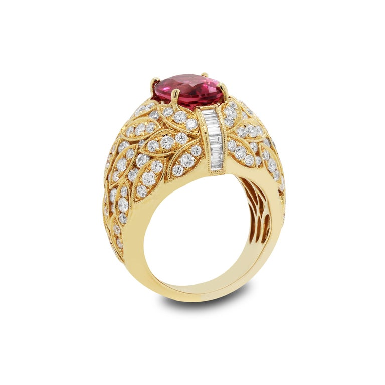18K Yellow Gold and Diamond Ring with Rubellite Tourmaline Center  Truly remarkable Rubellite Tourmaline center. Exceptional color and quality. 3.93 carat.  4 carat apprx. in diamonds. Round and baguette cuts.  Ring face is 0.75 inch in width 0.50