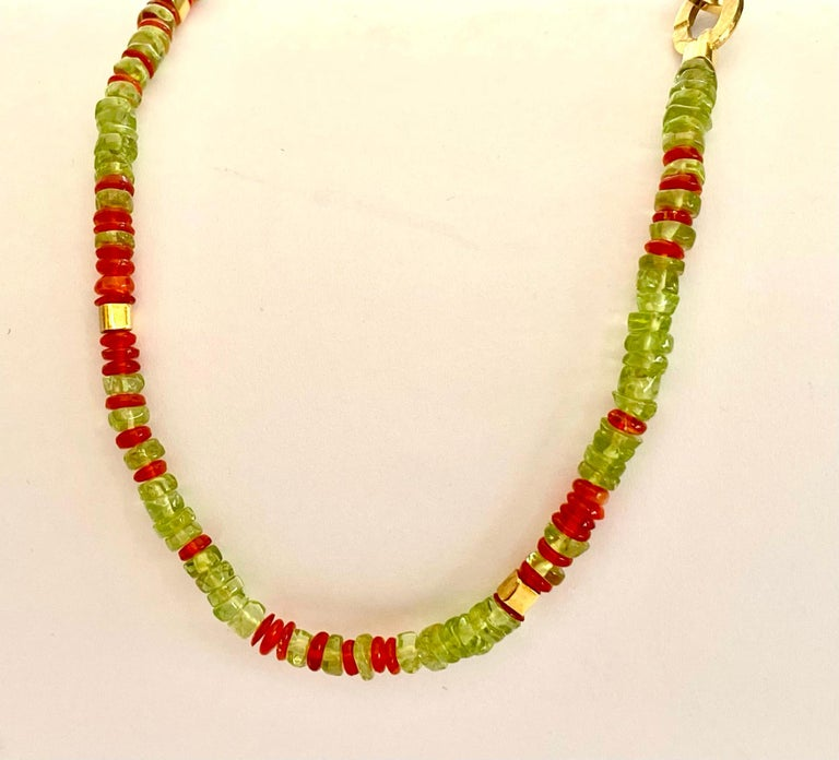 One (1) Colored Stone Necklace with 18 Karat Yellow Gold Lock and Cubic Beads. This Necklace is set with Natural Peridots and Natural Fire Opals. Hand made and one of a kind.  (Germany, Idar Oberstein 2015) Special 18K. Yellow Gold Lock. Lenghts: 44