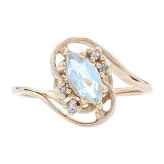 Yellow Gold Aquamarine & Diamond Bypass Ring, 14k Marquise Cut .49ctw