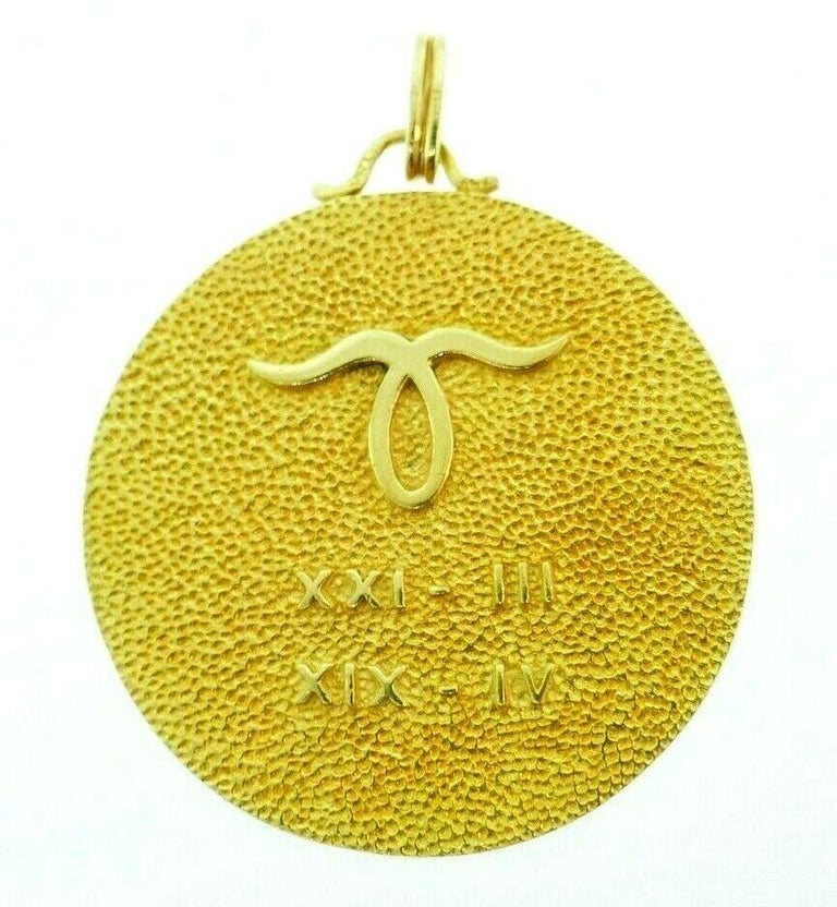 Chunky astrological/Zodiac Aries pendant made of 18k hammered yellow gold. Front side features a 3D sculptured figure of a jumping ram on a textured background Back side has an Aries symbol and Roman numbers (XXI-III and XIX-IV)   Stamped with a
