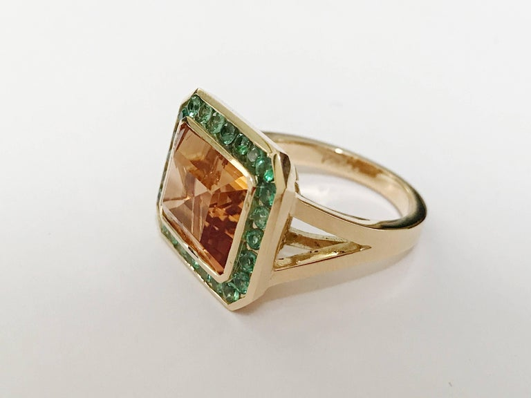 18kt Yellow Gold and Split Shank Ring with Emerald Cut Citrine Center Stone with surrounding Tsvaorite is an elegant cocktail ring. Measures 0.75 across the top.  This Ring can be made with any color center stone as well as type of surrounding