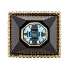 Yellow Gold Blue Topaz Onyx Modern Ring