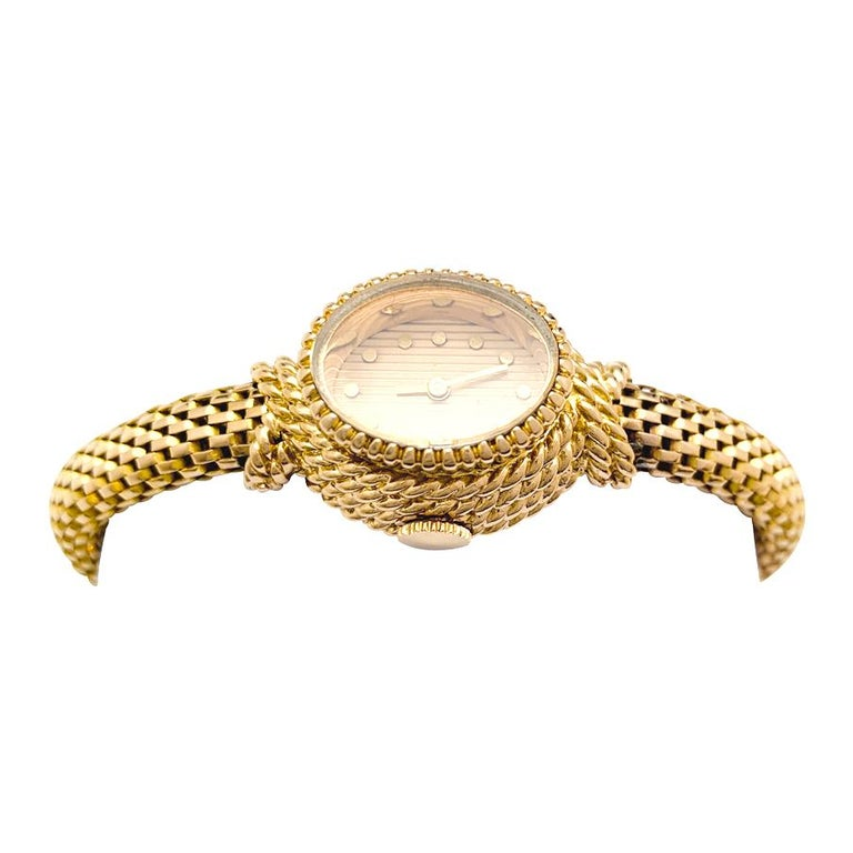 A 18Kt yellow gold Boucheron jewelry watch. Gold colour dial, appliqued round hours markers. Gross weight : 39.7 grams Manual winding movement. Signed and numbered. Maker's and Assay marks Original Boucheron box
