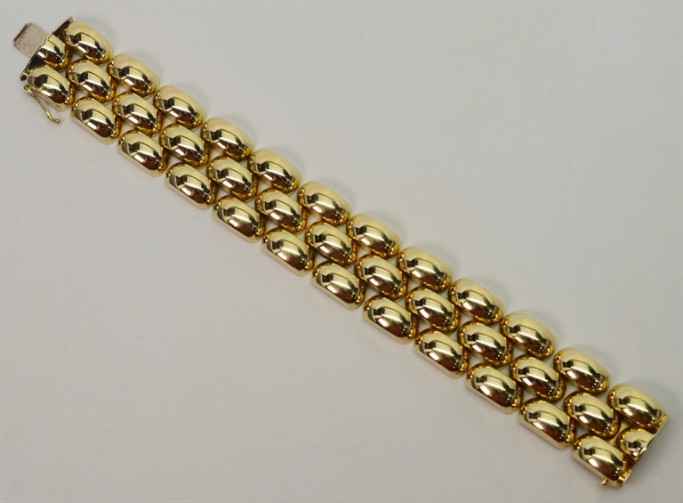 Make a gold statement with this exquisite retro bracelet. In the style of the 1950 to early 1960's, this substantial fourteen carat 14K Italian gold bracelet is made of distinctive bubble links hinged in an interesting alternating pattern which lend