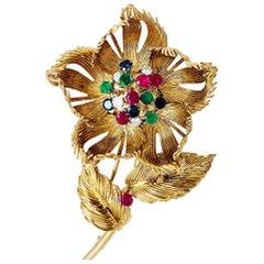 Yellow Gold Cartier Flower Brooch, Diamonds, Emerald, Rubies and Sapphires