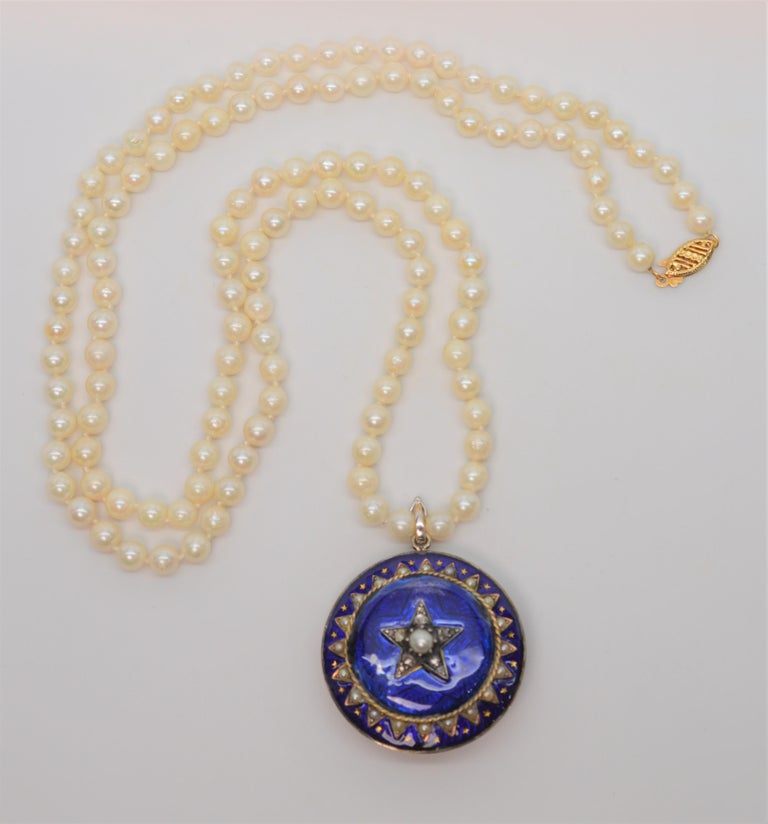 Antique style estate piece of 14 karat Yellow Gold and Cobalt Blue Enamel Pin Pendant with Pearl and Diamond Accents. This celestial brooch sits on a thirty inch strand of natural 5-1/4mm Akoya Pearls with an enhancer clip and finished with a 14