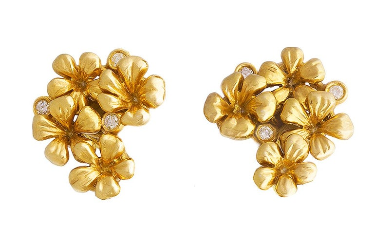 These 14 karat yellow gold Plum Blossom modern style cocktail clip-on earrings are encrusted with 6 round diamonds and and neon paraiba tourmalines in pear cut, 2 carats in total, 8,7x5,4 mm each. This jewellery collection was featured in Vogue UA