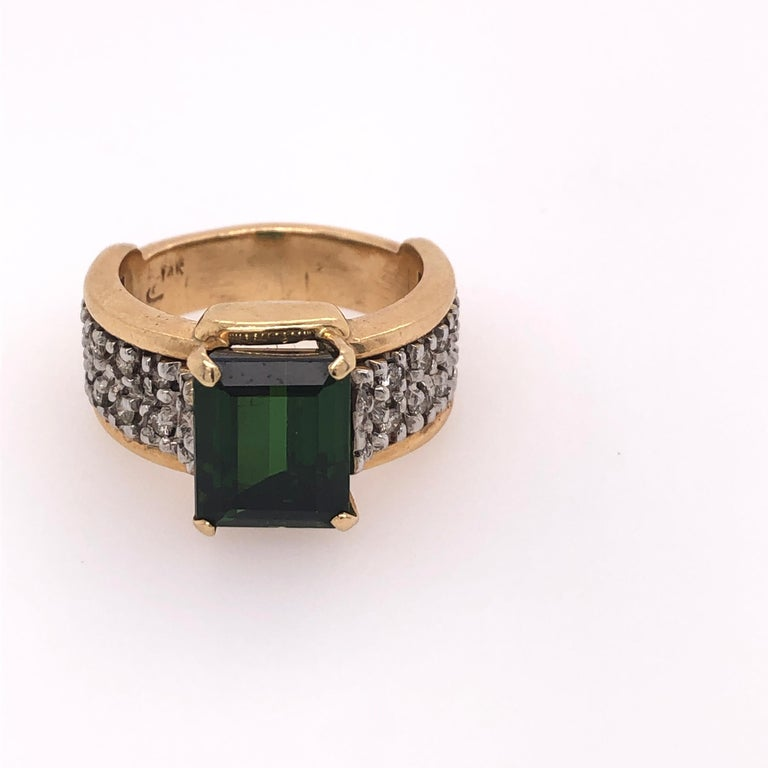 14K Yellow Gold Green Tourmaline Ring with Diamonds. There are 24 round diamonds in this classic ring.    From the Skibell Estate Collection  Stamped: 14K  Size: 7.75
