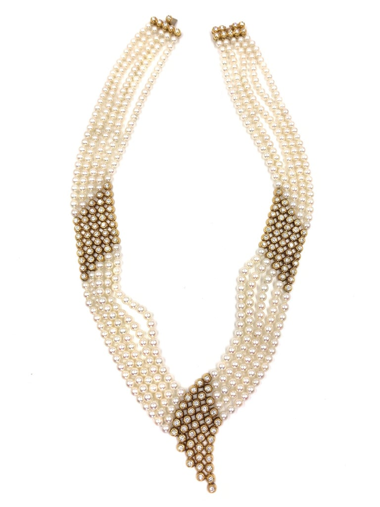 An exquisite necklace with modern appeal yet a not-so-subtle nod to fabulous Gatsby era jewelry. This five strand piece is designed to lay beautifully and comfortably on the neck with a feminine curved V drop in the center. Each strand is composed