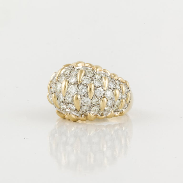 18K yellow gold ring in a Bombay style.  The dome holds fifty (50) round diamonds totaling 3.5 carats; they are H-J in color and VS1-SI1 in clarity.  Ring is currently a size 8.  Measures 7/8