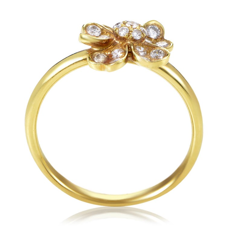 Shine with effortlessly chic style as you don this lovely ladies ring. The yellow gold band base is flawlessly shaped, setting off the intricate beauty of the flower-shaped top highlighted by an array of white diamonds weighing in total 0.36ct.<br