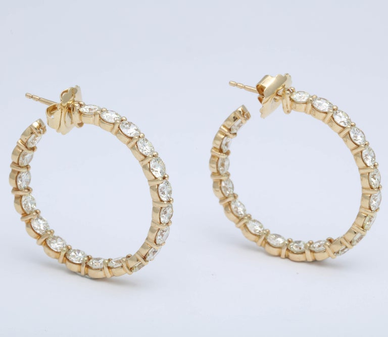 An amazing pair of important Diamond Hoop Earrings with LARGE white diamonds!  13.20 carats of round brilliant cut white diamonds set in 18k yellow gold.   Each diamond averages over 0.30 carats.   The hoops were custom designed in New York --