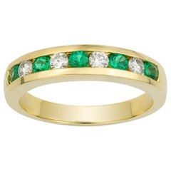 Yellow Gold Emerald and Diamond Half Eternity Ring