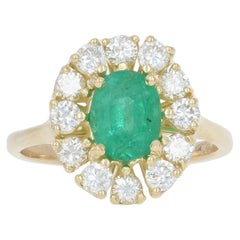 Yellow Gold Emerald and Diamond Ring, 14 Karat Oval Cut 1.86 Carat Halo