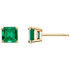 Yellow Gold Emerald Cut Colombia Emerald Stud Earrings Weighing 1.10 Carat
