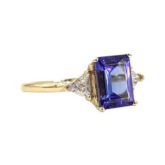 Yellow Gold Emerald Cut Tanzanite and Diamond Three-Stone Ring