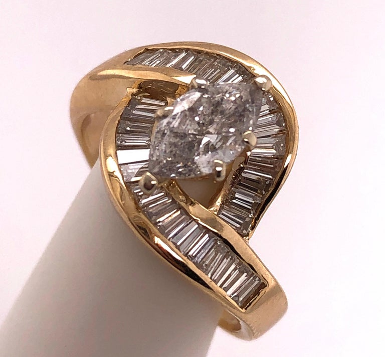 Yellow Gold Free Style Ring with Diamonds.  0.75 carat center diamond and 34 pcs. baguette diamonds Size 7.75 with 5.6 grams total weight