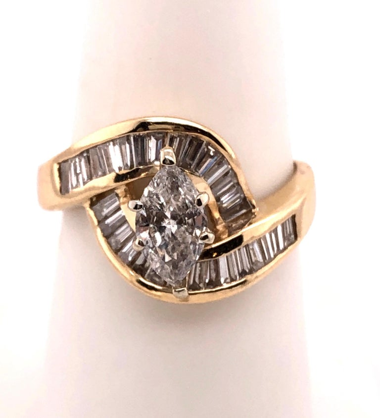 Oval Cut Yellow Gold Free Style Ring with Diamonds For Sale