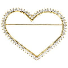 Yellow Gold Heart Shape Brooch Features Diamonds