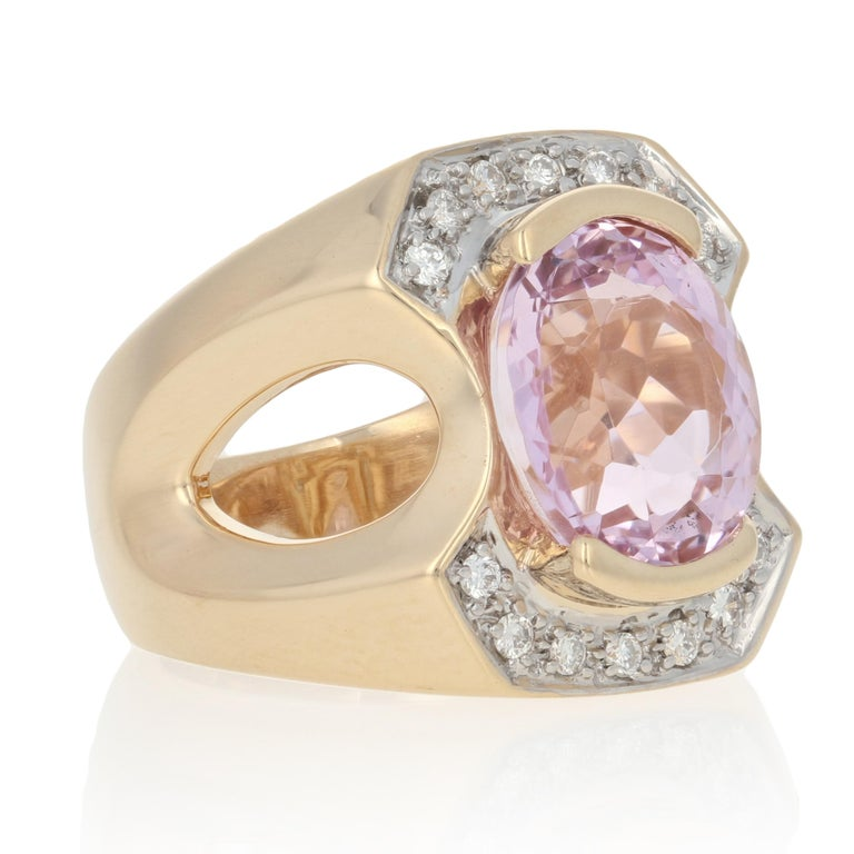 Size: 6 Sizing Fee: Up 1 size for $50  Metal Content: Guaranteed 14k Gold as stamped (yellow and white)  Stone Information:  Genuine Kunzite Color: Pink Cut: Oval Carat(s): 5.85ct  Natural Diamonds   Clarity: SI1 Color: G - H  Cut: Round Brilliant