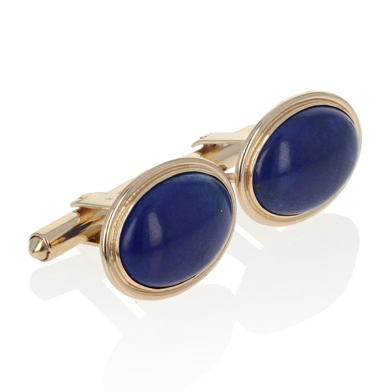 Metal Content: Guaranteed 14k Gold as stamped  Stone Information:  Genuine Lapis Lazuli Color: Blue Cut: Oval Cabochon  Each Cufflink's Face:  Long: 5/8
