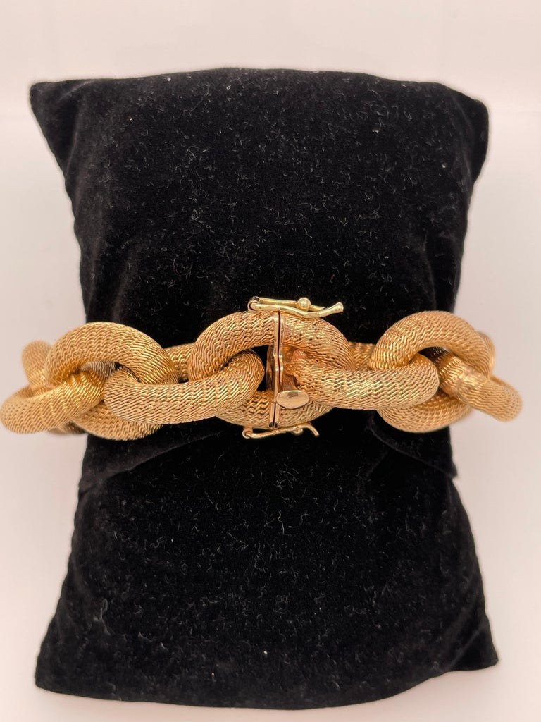 Exceptionally made Italian yellow gold link bracelet.  This bracelet is 18K yellow gold, compromised of interlocking woven mesh oval links. This statement piece has somewhat of a matte finish to it. This fine piece is an everyday staple to any