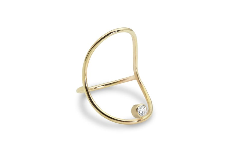 An elegant hand-formed solid 14k gold oval holds a brilliant white .10ct diamond that seems to float on the finger.  It's bold and delicate at the same time - minimal with a bit of surrealist magic, and it's streamlined design makes it very