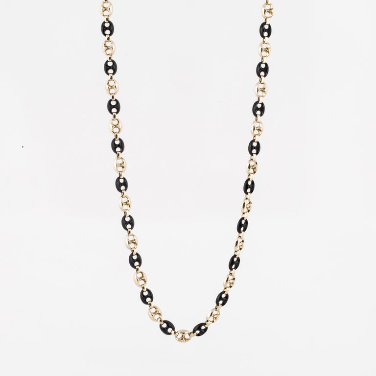 14K yellow gold and onyx necklace.  Alternating gold and onyx anchor links in this 30
