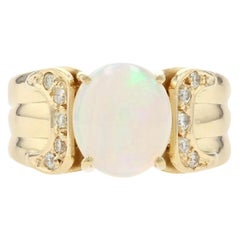 Yellow Gold Opal and Diamond Ring, 18 Karat Oval Cabochon Cut 1.75 Carat Ribbed