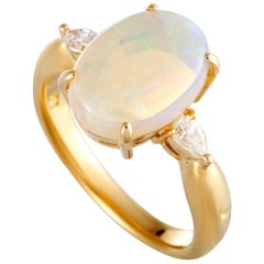 Yellow Gold Pear Diamond and Opal Oval Ring