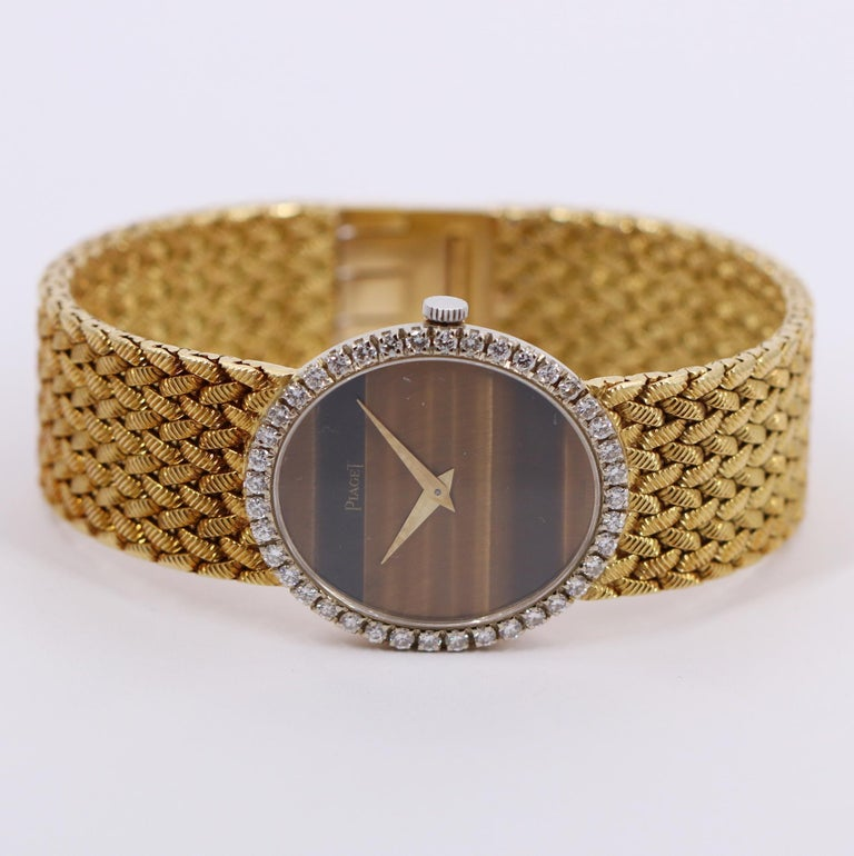 Yellow Gold Piaget Watch with Diamond Bezel and Oval Tiger's Eye Dial For Sale 1