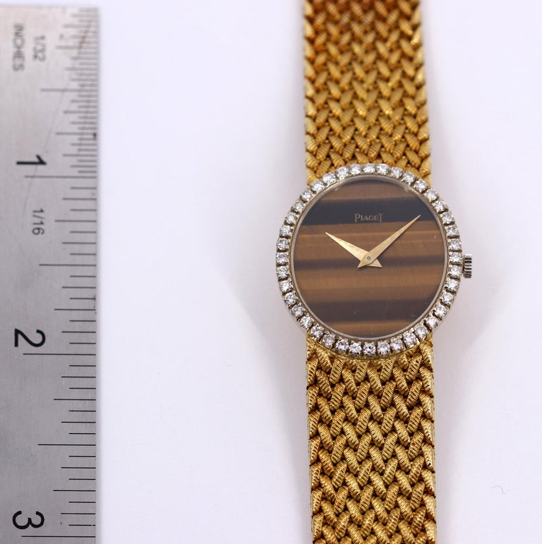 Yellow Gold Piaget Watch with Diamond Bezel and Oval Tiger's Eye Dial For Sale 2